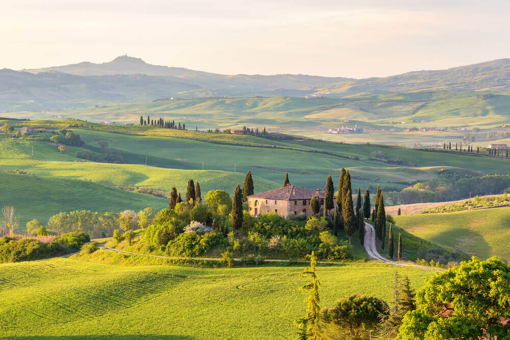 breathtaking landscapes in Europe. House on a hill in Tuscany landscape