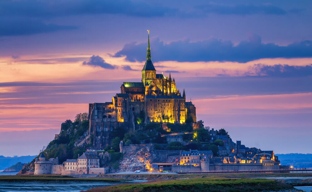 breathtaking landscapes in Europe. Mont Saint-Michel view in the sunset light. Normandy, northern France