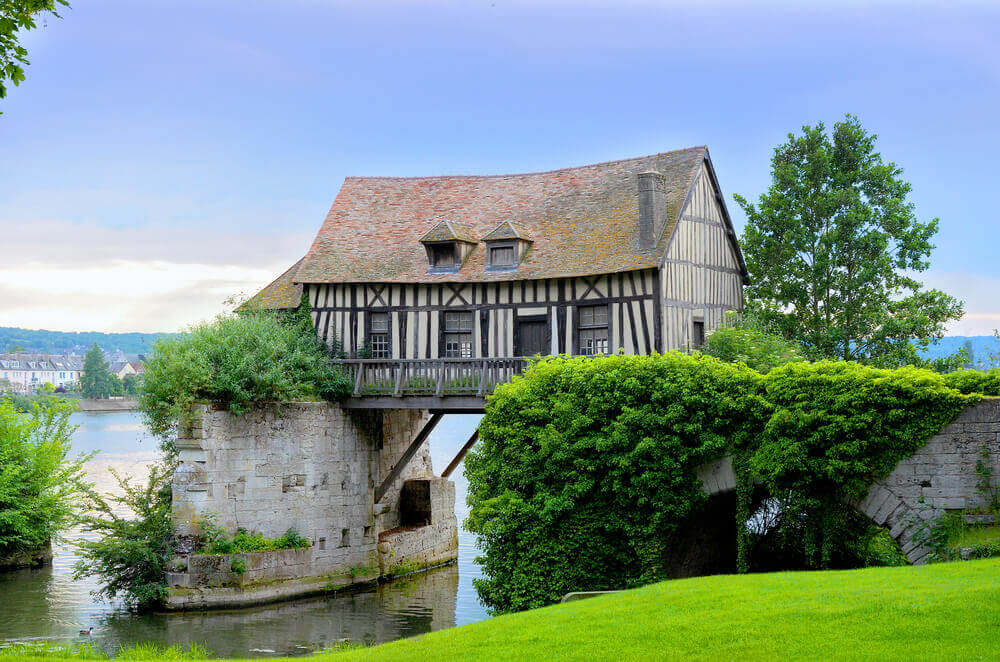 Old mill house on bridge,Vernon, Normandy, France planning a trip to France