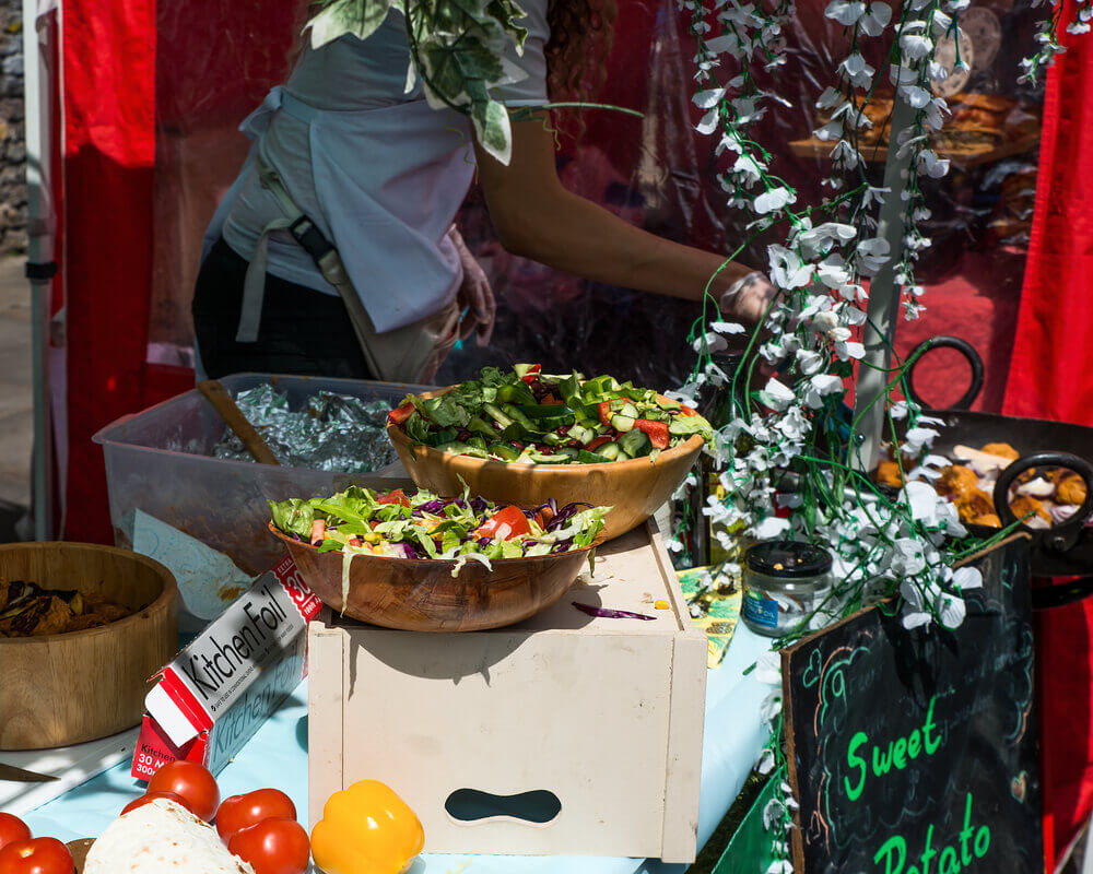 Colorful and tasty salads in Brick Lane Market stand. London Holiday