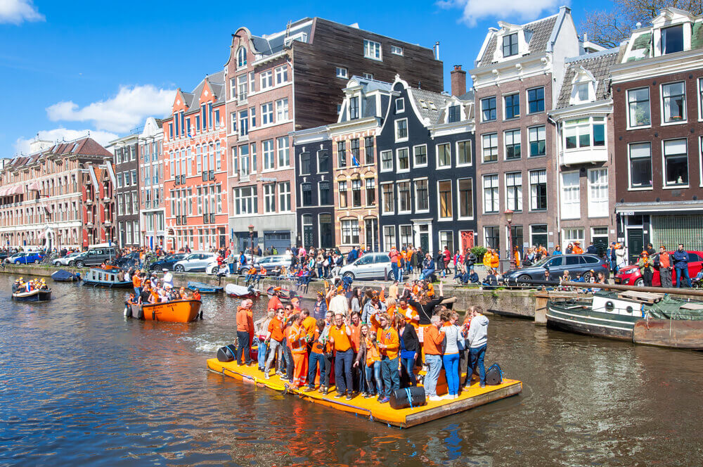 King's day celebrations in Amsterdam canals