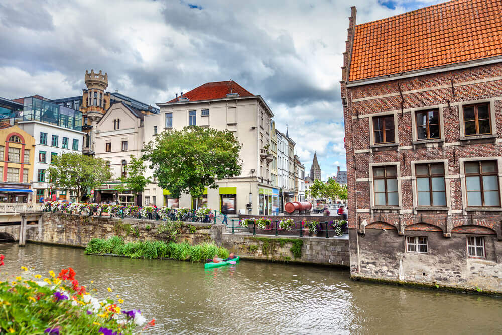 Holiday in Belgium: Canal overlooking well manicured flowers in the centre of town