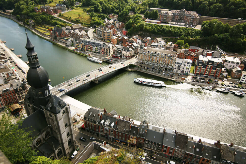 Holiday in Belgium: Birds eye view of river in Dinant with bridge between sides- city and country