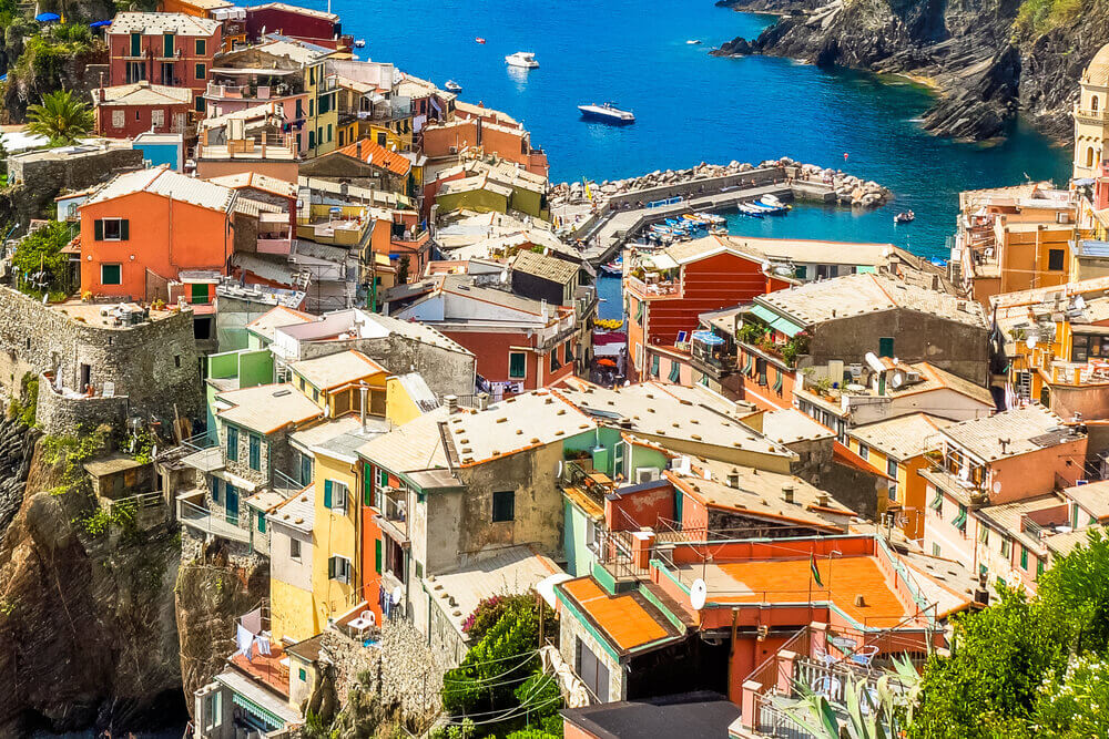 planning a trip to Italy. Beautifil view from high hill of Vernazza houses and blue sea, Cinque Terre national park, Liguria, Italy.