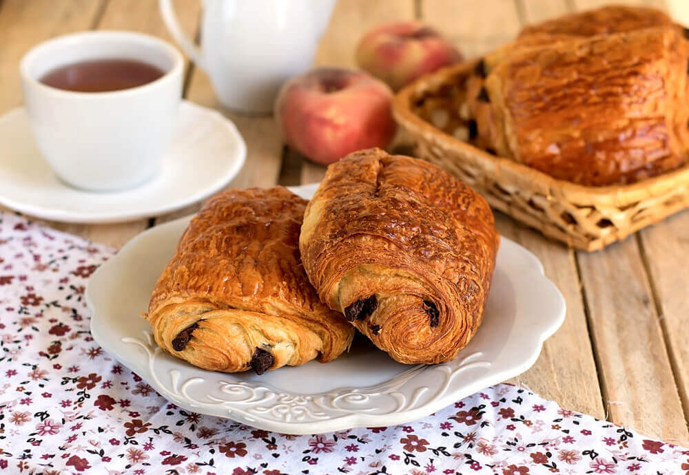 Chocolate croissants (pain au chocolat) with tea for breakfast.