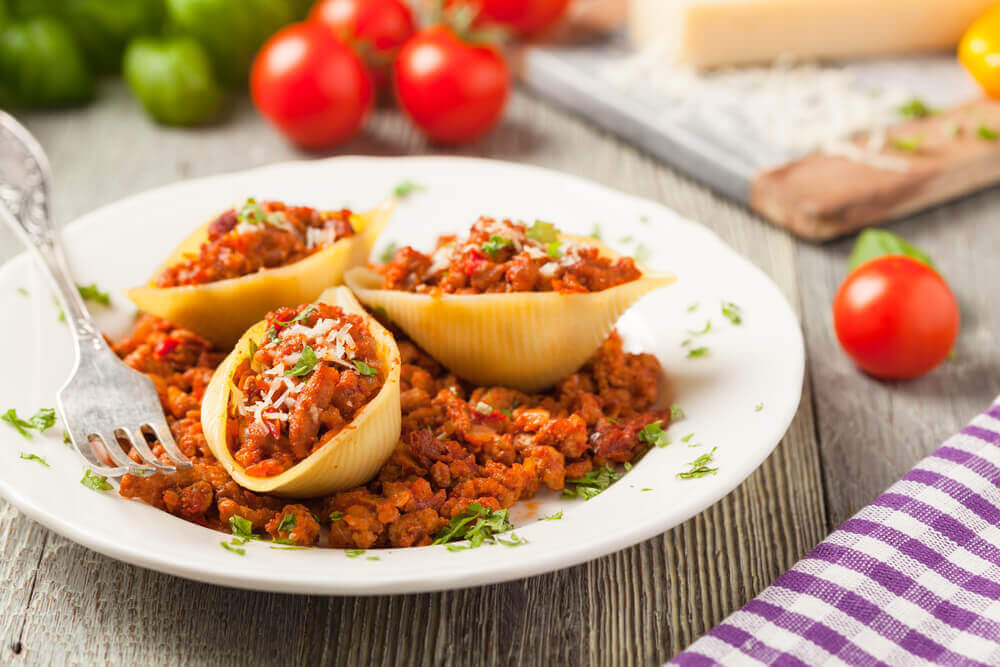 Italian pasta Conchiglioni Rigati stuffed with dry tomatoes and meat. attractions in Italy