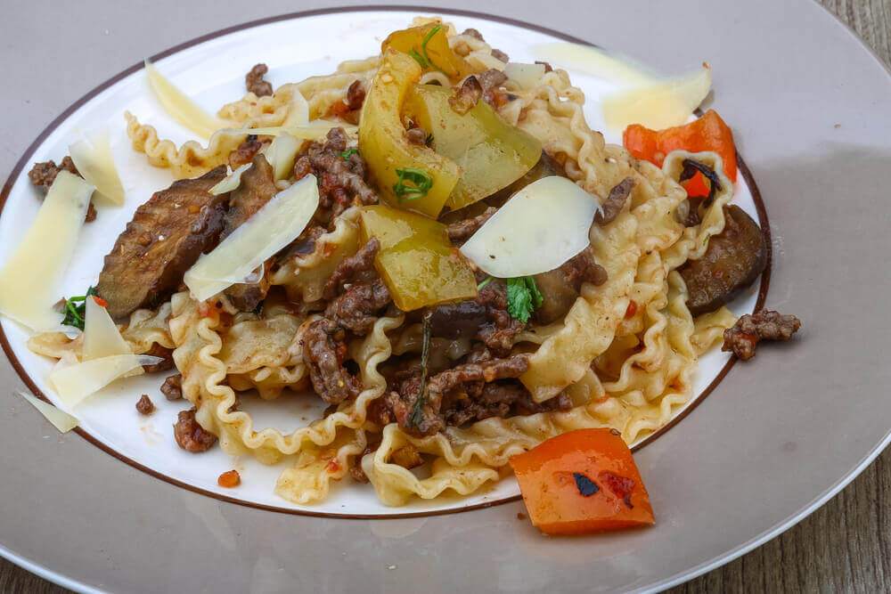 Italian traditional Pasta mafalde with herbs and beef meat. attractions in Italy