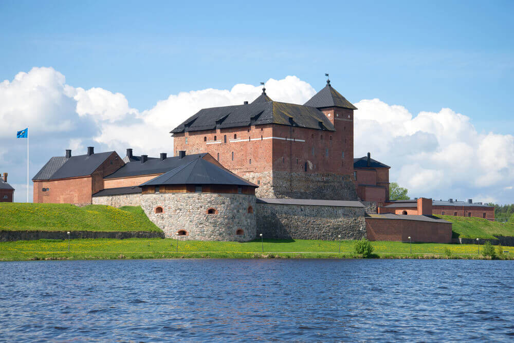 Trip to Finland. Medieval fortress of Hameenlinna on the shore of Vanajavesi lake on a July day. Finland