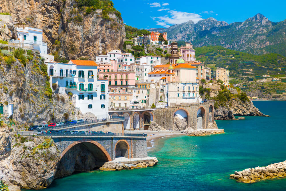 Morning view of Amalfi cityscape on coast line of Mediterranean sea. attractions in Italy