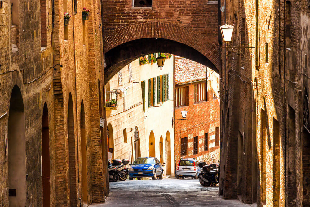 planning a trip to Italy. Old street in medieval Siena, Tuscany, Italy.