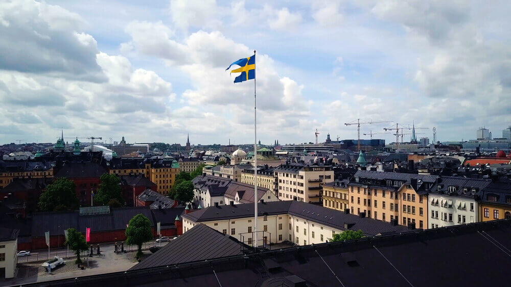 trip to Sweden. Swedish Flag with aerial panoramic view of The Old Town , Gamla Stan , Stockholm , Sweden.