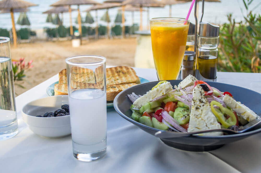 travel to europe. Greek food and drinks served in a restaurant near beach