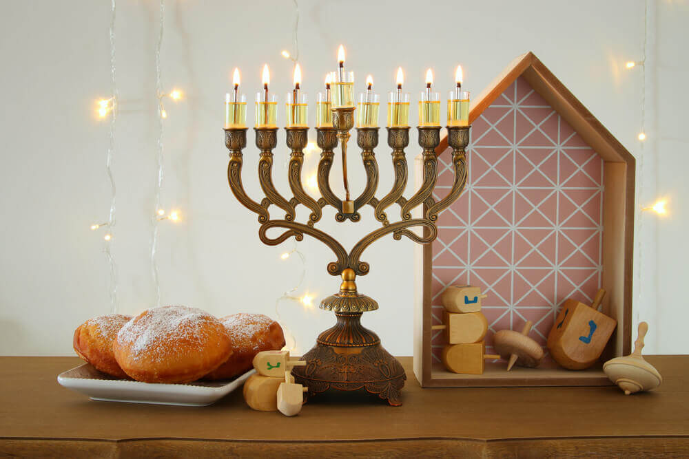 planning your trip. Image of jewish holiday Hanukkah background with traditional spinnig top, menorah (traditional candelabra) and burning candles