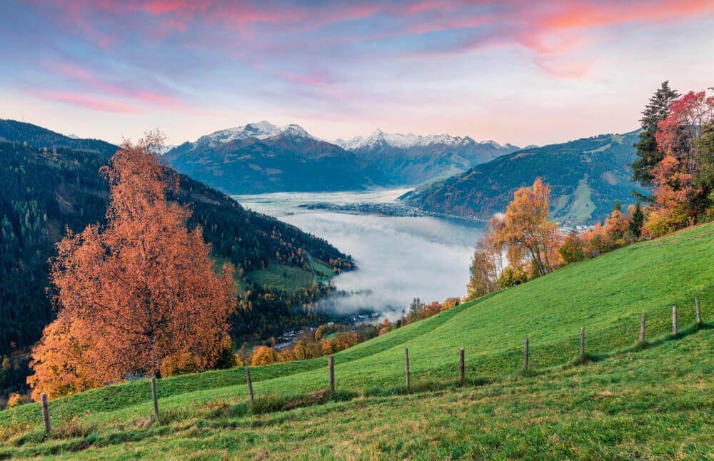 plan your trip. Splendid view of Zell lake. Impressive autumn sunrise of Austrian town - Zell am See, south of the city of Salzburg.