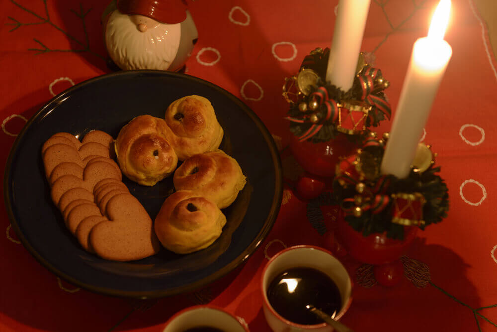 planning your trip. Swedish Lucia celebration with Lucia buns, ginger cookies and mulled wine