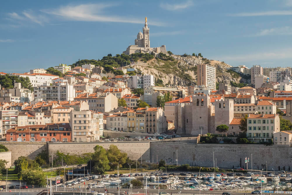 travel to europe. Views of Marseille with famous church of Notre-Dame de la Garde on a beautiful summer day.