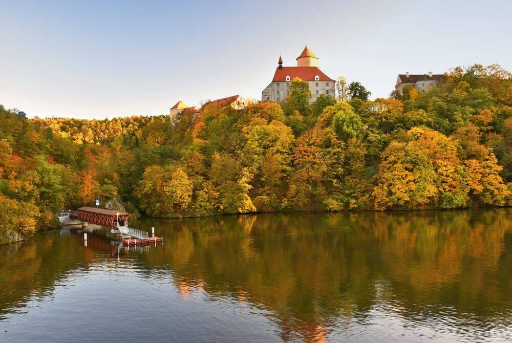 Europe road trip. Beautiful Autumn Landscape with Veveri Castle. Natural colorful scenery with sunset. Brno dam, Czech Republic - Europe.