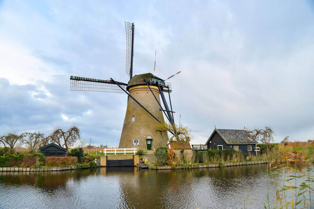 plan a trip to Europe. Beautiful old windmills in Kinderdijk. Autumn morning in Holland, Netherlands.
