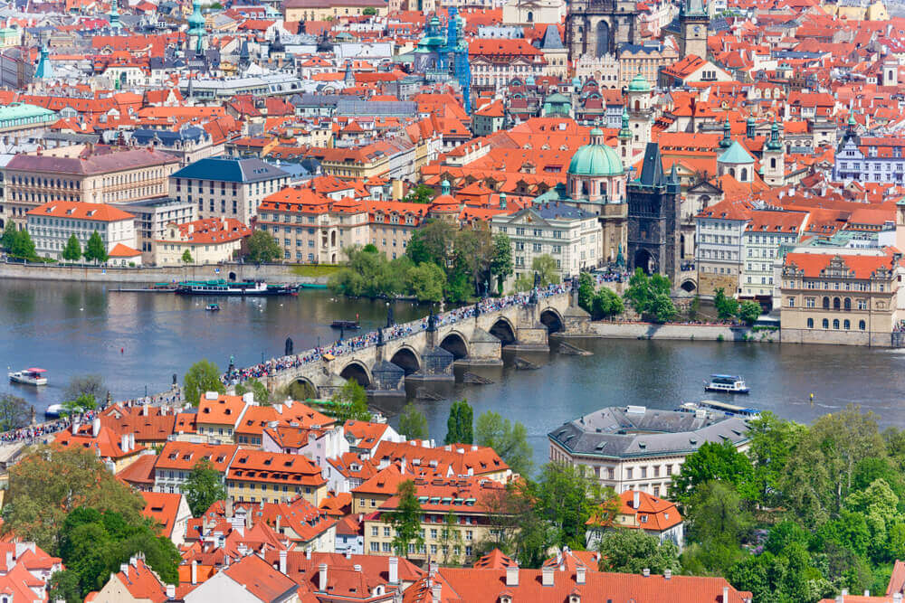 Europe road trip. Charles bridge, Moldau (Vltava) river, Lesser Town and Old town, Prague (UNESCO), Czech republic - view from watchtower - panorama of golden city