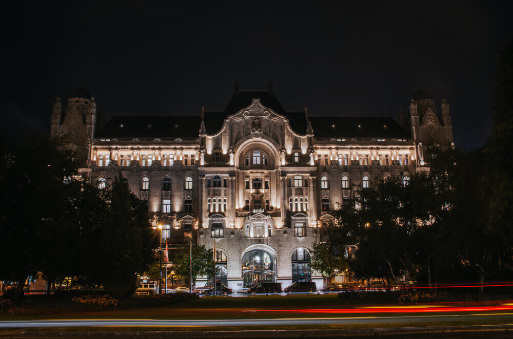 road trip map. Gresham palace nicely illuminated at night in Budapest, Hungary Art Nouveau architecture in Budapest