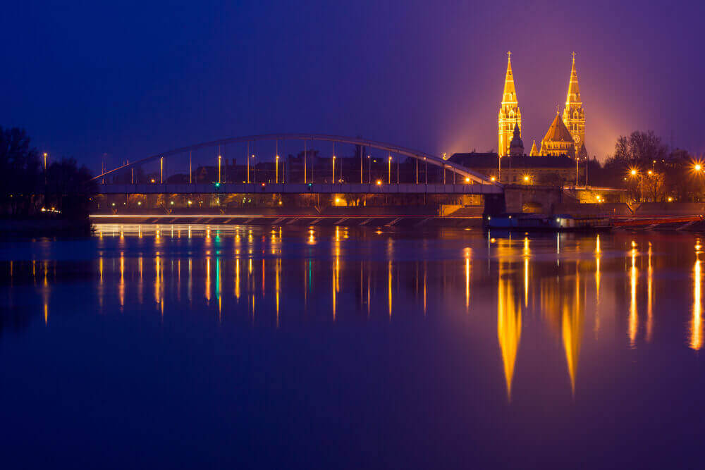 road trip map. Night view of Szeged city from the other side of Tisza River-Hungary