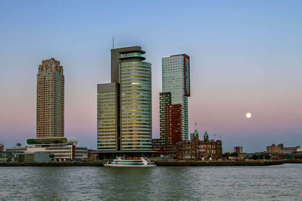 plan a trip to Europe. ROTTERDAM, HOLLAND. Rotterdam city center in the evening. South Holland. Skyscrapers on the shore.