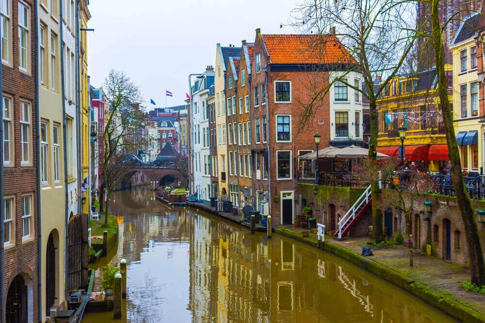 plan a trip to Europe. The most famous canals and embankments of Utrecht city at winter