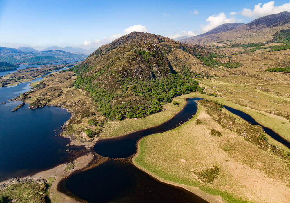 Aerial Panorama view Killarney National Park on the Ring of Kerry, County Kerry, Ireland. Beautiful panoramic scenic aerial of a natural irish countryside landscape. Part of the Wild Atlantic Way. Ireland road trip