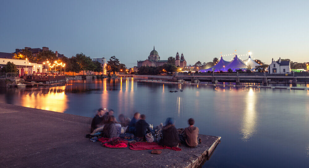 during Galway Art Festival with Big Top and Cathedral on the bank of Corrib river in Galway, Ireland. Ireland road trip