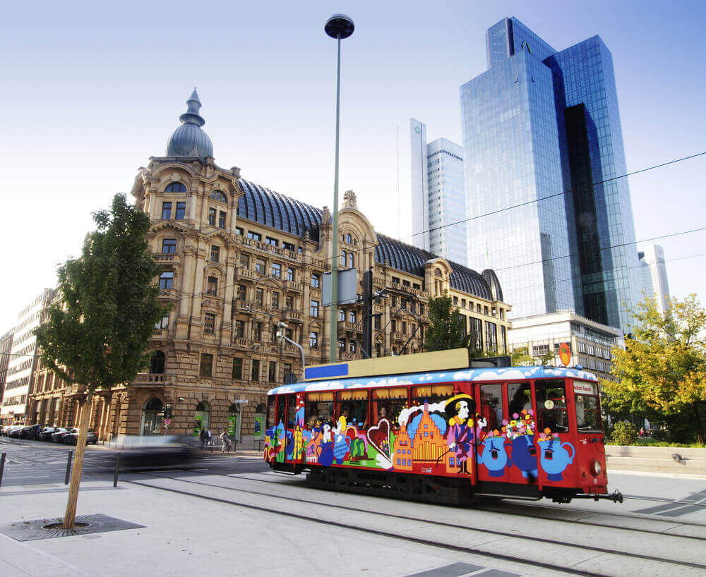A colorful electric tram or train in Frankfurt. vacation planner
