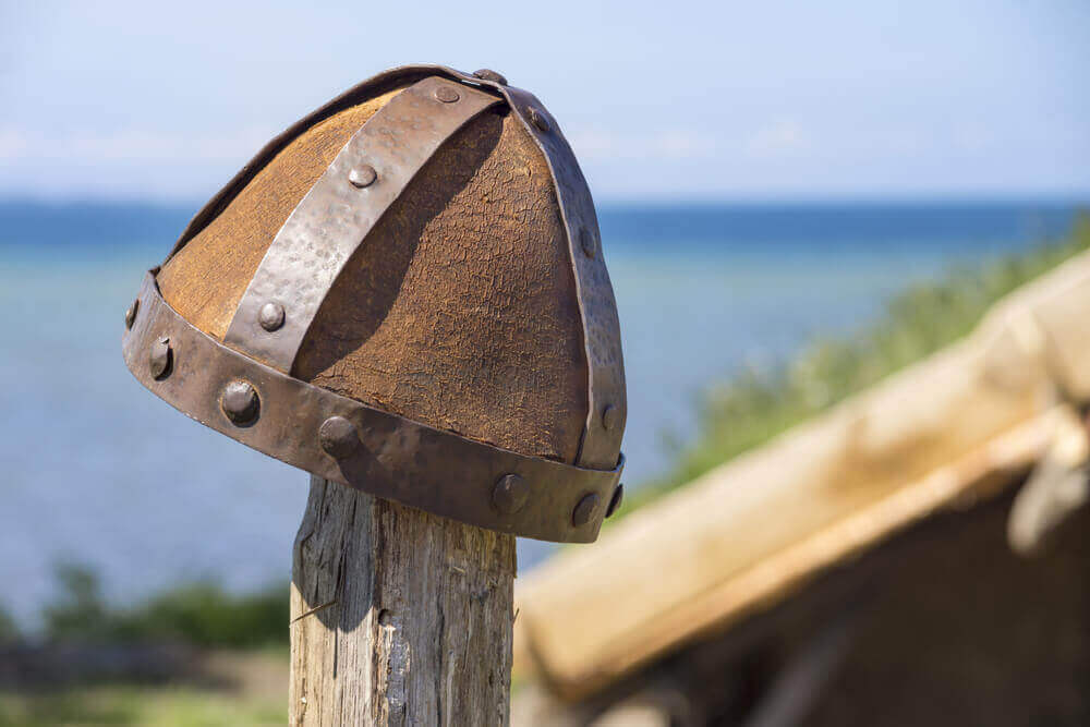 authentic restored viking helmet under the high midday sun. viking tour