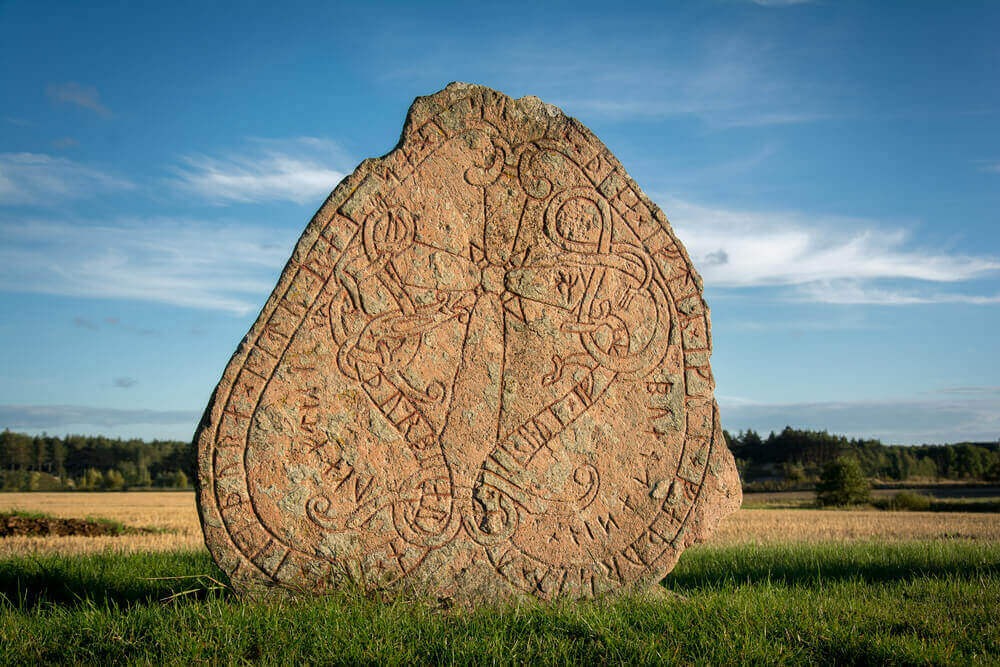 Rune stone in Sweden. Carved a thousand years ago by vikings. viking tour