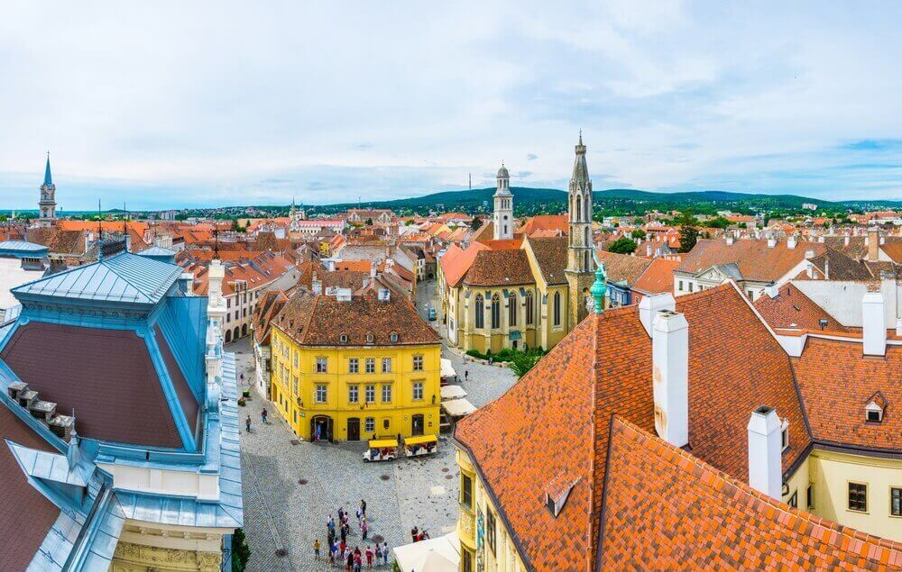European music festival. Aerial view of the Fo ter - the main square in the hungarian city Sopron including holy trinity column and the Goat church
