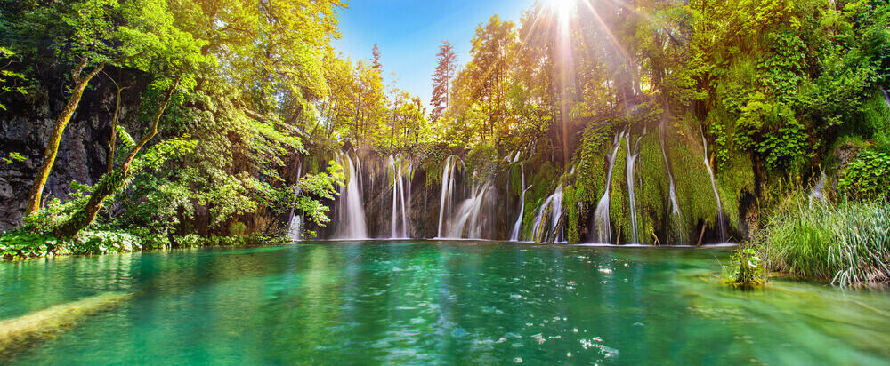 Cheap holiday to Croatia. Breathtaking waterfalls panorama in Plitvice Lakes National Park, Croatia, Europe.