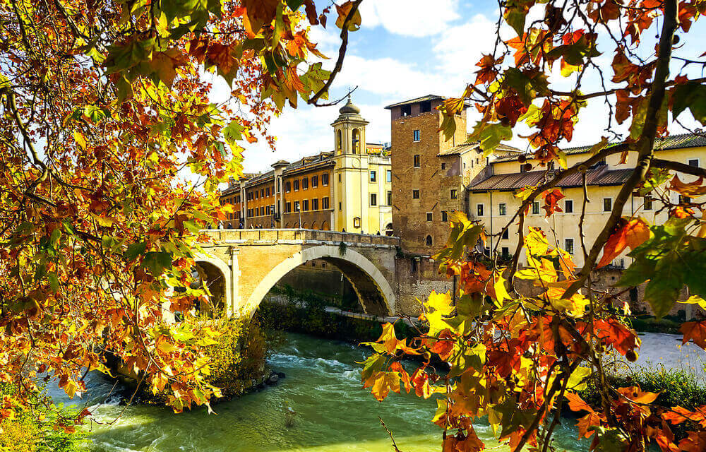 Autumn in Rome. Roman bridge autumn landscape. . Italy in September