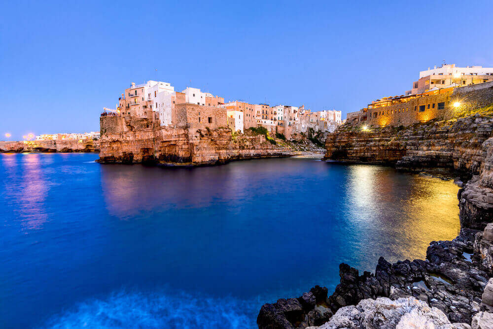 Puglia, Italy. Sunset scenery of Polignano a Mare, town in the province of Bari, Apulia, southern Italia on the Adriatic Sea. Italy in September