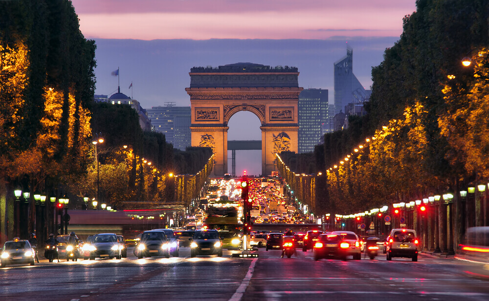 Champs Elysees, Paris at night on your trip to Paris