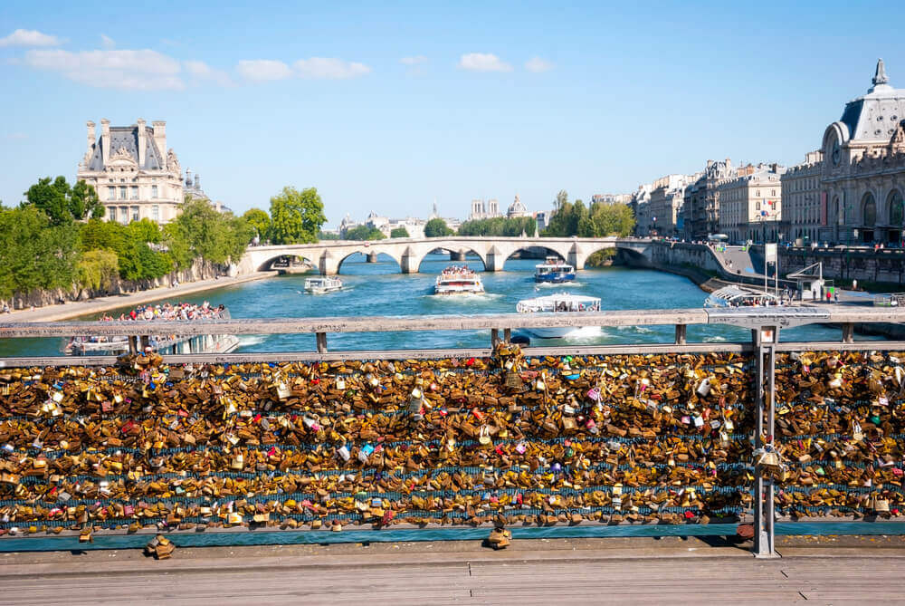Take a walk across the bridge of Pont de Arts on your trip to Paris
